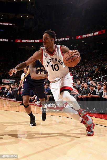 DeMar DeRozan of the Toronto Raptors drives to the basket against the New Orleans Pelicans on November 13 2015 at the Air Canada Centre in Toronto...