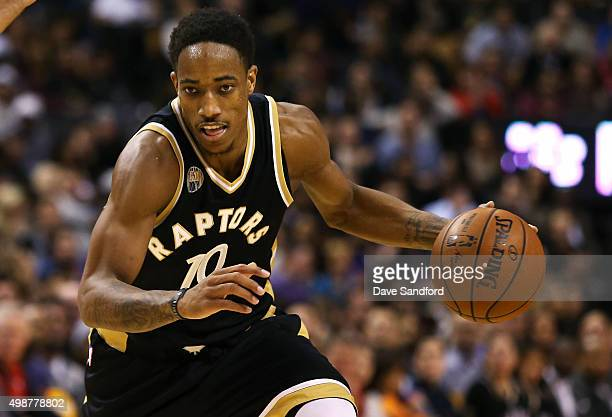 DeMar DeRozan of the Toronto Raptors drives to the basket against the Cleveland Cavaliers on November 25 2015 at Air Canada Centre in Toronto Ontario...
