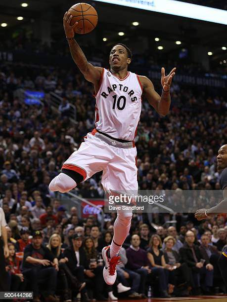 DeMar DeRozan of the Toronto Raptors drives to the basket against the Golden State Warriors on December 5 2015 at Air Canada Centre in Toronto...