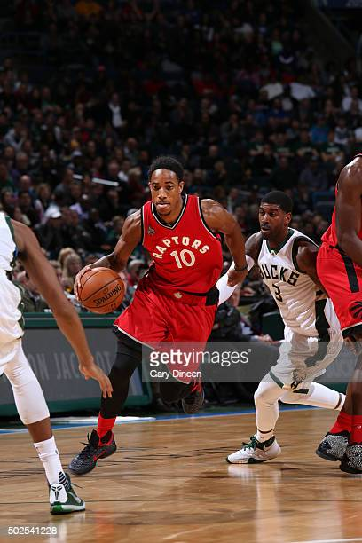 DeMar DeRozan of the Toronto Raptors drives to the basket against the Milwaukee Bucks during the game on December 26 2015 at BMO Harris Bradley...