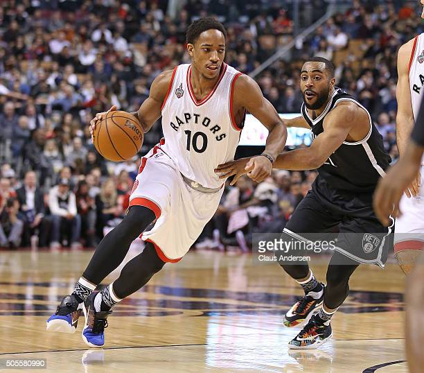 DeMar DeRozan of the Toronto Raptors drives to the basket against the Brooklyn Nets during an NBA game at the Air Canada Centre on January 182016 in...