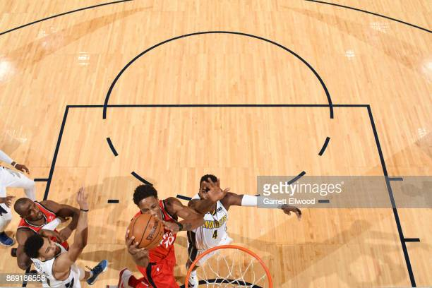 DeMar DeRozan of the Toronto Raptors drives to the basket against the Denver Nuggets on November 1 2017 at the Pepsi Center in Denver Colorado NOTE...