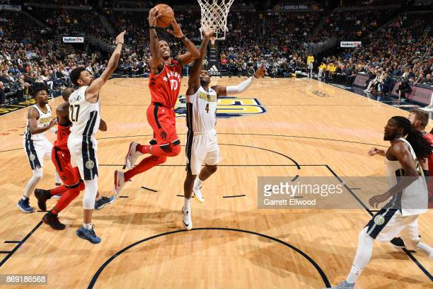 DeMar DeRozan of the Toronto Raptors drives to the basket against the Denver Nuggets on November 1 2017 at the Pepsi Center in Denver Colorado NOTE...