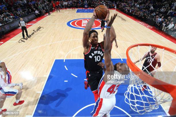 DeMar DeRozan of the Toronto Raptors drives to the basket against the Detroit Pistons on March 7 2018 at The Palace of Auburn Hills in Auburn Hills...