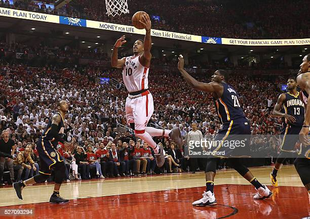 DeMar DeRozan of the Toronto Raptors drives to the basket as Ian Mahinmi of the Indiana Pacers looks on during Game Seven of the Eastern Conference...