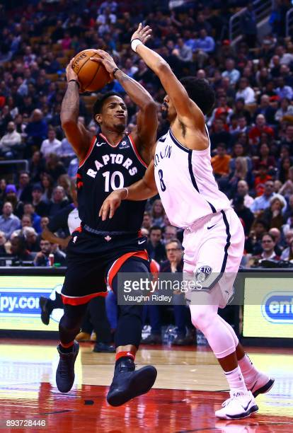 DeMar DeRozan of the Toronto Raptors drives to the basket as Spencer Dinwiddie of the Brooklyn Nets defend during the first half of an NBA game at...
