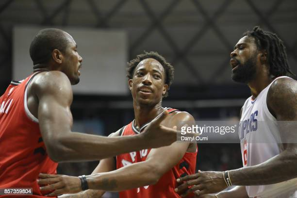 DeMar DeRozan of the Toronto Raptors gets between teammate Serge Ibaka and DeAndre Jordan of the Los Angeles Clippers during the third quarter at the...