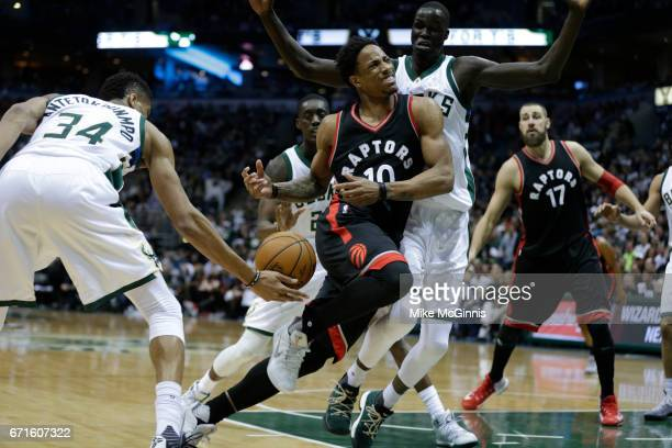 DeMar DeRozan of the Toronto Raptors gets4 stripped of the basketball by Giannis Antetokounmpo of the Milwaukee Bucks during the second half of Game...