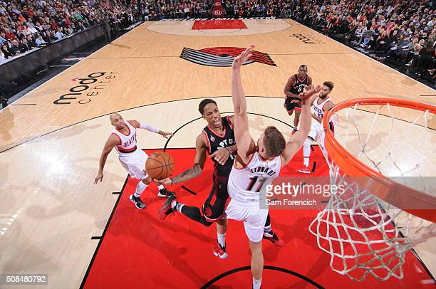 DeMar DeRozan of the Toronto Raptors goes to the basket against Meyers Leonard of the Portland Trail Blazers on February 4 2016 at the Moda Center in...