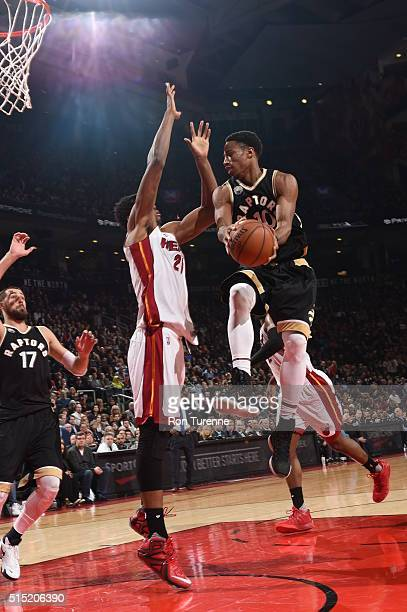 DeMar DeRozan of the Toronto Raptors goes to the basket against the Miami Heat on March 12 2016 at the Air Canada Centre in Toronto Ontario Canada...