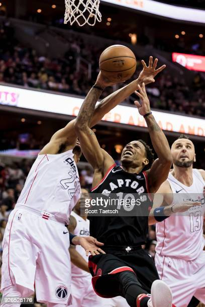 DeMar DeRozan of the Toronto Raptors goes to the basket against the Washington Wizards during the first half at Capital One Arena on March 2 2018 in...