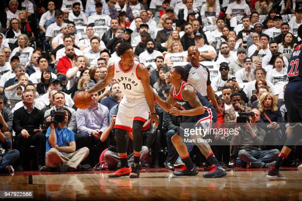 DeMar DeRozan of the Toronto Raptors handles the ball against Bradley Beal of the Washington Wizards in Game Two of Round One of the 2018 NBA...