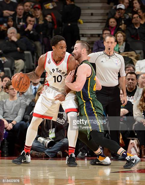 DeMar DeRozan of the Toronto Raptors handles the ball against Gordon Hayward of the Utah Jazz on March 2 2016 at the Air Canada Centre in Toronto...