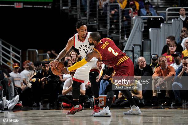 DeMar DeRozan of the Toronto Raptors handles the ball against Kyrie Irving of the Cleveland Cavaliers during a game on November 15 2016 at Quicken...
