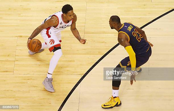 DeMar DeRozan of the Toronto Raptors handles the ball against LeBron James of the Cleveland Cavaliers in Game Four of the Eastern Conference Finals...