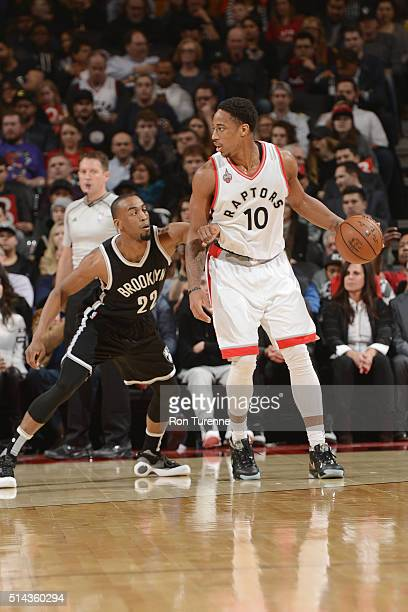 DeMar DeRozan of the Toronto Raptors handles the ball against Markel Brown of the Brooklyn Nets on March 8 2016 at the Air Canada Centre in Toronto...