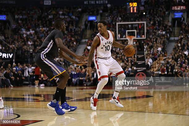 DeMar DeRozan of the Toronto Raptors handles the ball against the Golden State Warriors on December 5 2015 at Air Canada Centre in Toronto Ontario...