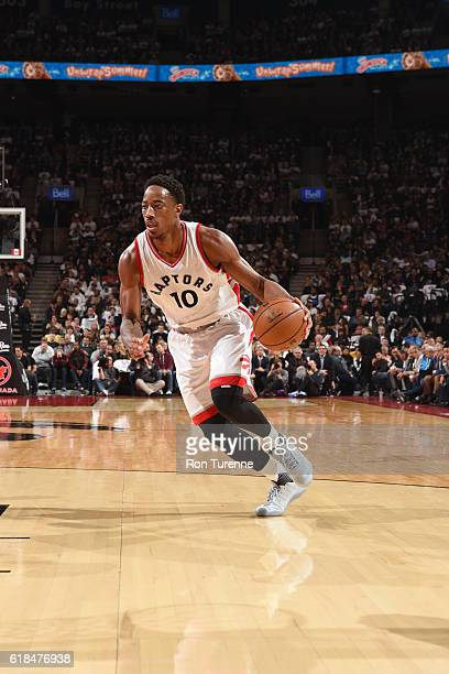 DeMar DeRozan of the Toronto Raptors handles the ball against the Detroit Pistons on October 26 2016 at the Air Canada Centre in Toronto Ontario...