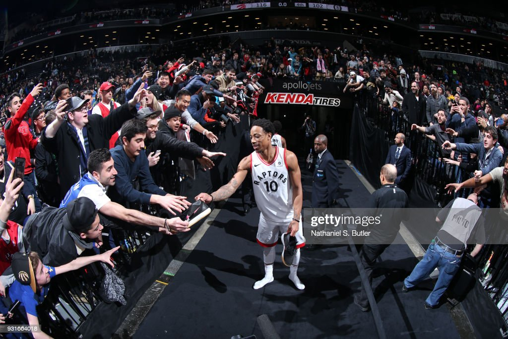 DeMar DeRozan #10 of the Toronto Raptors hands his sneaker to a fan after the game against the Brooklyn Nets on March 13, 2018 at Barclays Center in Brooklyn, New York.