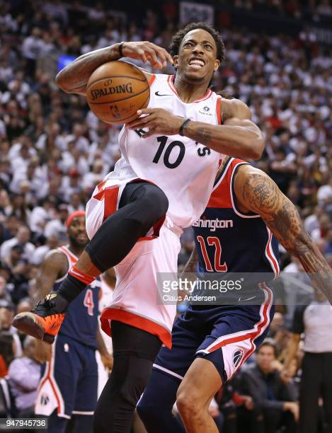 DeMar DeRozan of the Toronto Raptors is fouled by Kelly Oubre Jr #12 of the Washington Wizards in Game Two of the Eastern Conference First Round in...