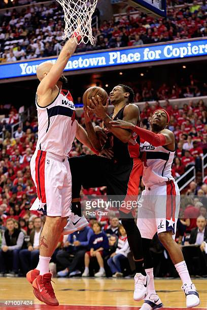 DeMar DeRozan of the Toronto Raptors is fouled by Paul Pierce as Marcin Gortat of the Washington Wizards guards in the second quarter of Game Three...
