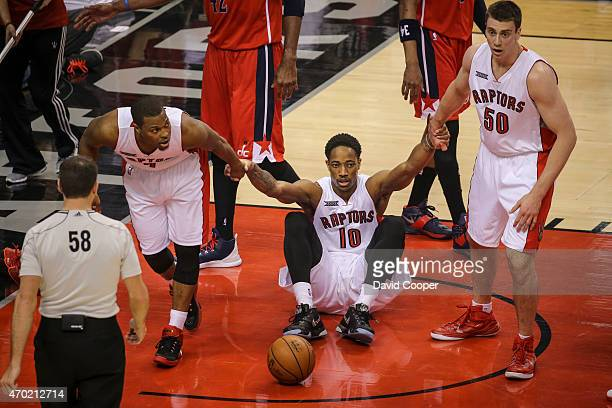 TORONTO ON APRIL 18 DeMar DeRozan of the Toronto Raptors is helped up to his feet by Kyle Lowry and Tyler Hansbrough after he was fouled during the...