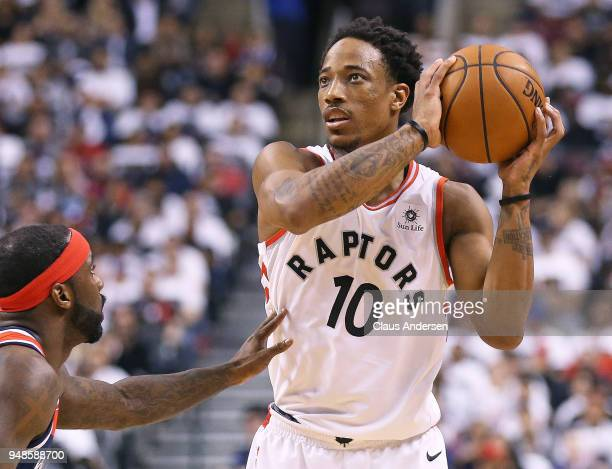 DeMar DeRozan of the Toronto Raptors keeps an eye on the shot clock against the Washington Wizards in Game Two of the Eastern Conference First Round...