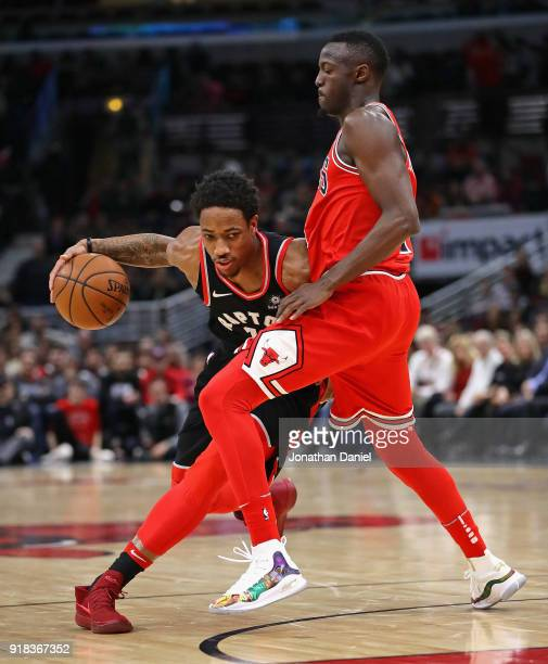 DeMar DeRozan of the Toronto Raptors moves against Jerian Grant of the Chicago Bulls at the United Center on February 14 2018 in Chicago Illinois...