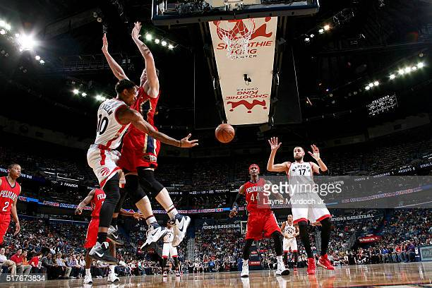 DeMar DeRozan of the Toronto Raptors passes the ball to Jonas Valanciunas of the Toronto Raptors during the game against the New Orleans Pelicans on...