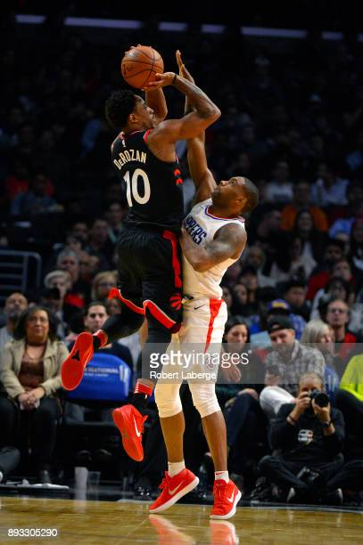 DeMar DeRozan of the Toronto Raptors plays against Sindarius Thornwell of the Los Angeles Clippers on December 11 2017 at STAPLES Center in Los...