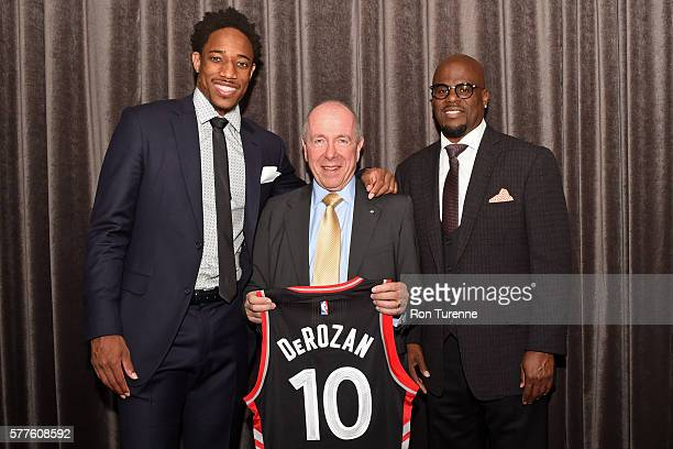 DeMar DeRozan of the Toronto Raptors pose for a photo with Agent Aaron Goodwin and Larry Tanenbaum Chairman of Maple Leaf Sports Entertainment during...