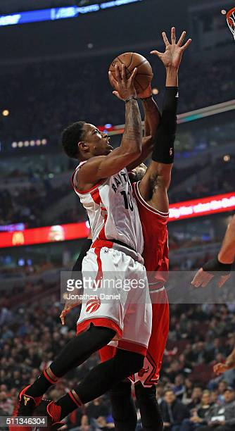 DeMar DeRozan of the Toronto Raptors puts up a shot against Taj Gibson of the Chicago Bulls at the United Center on February 19 2016 in Chicago...