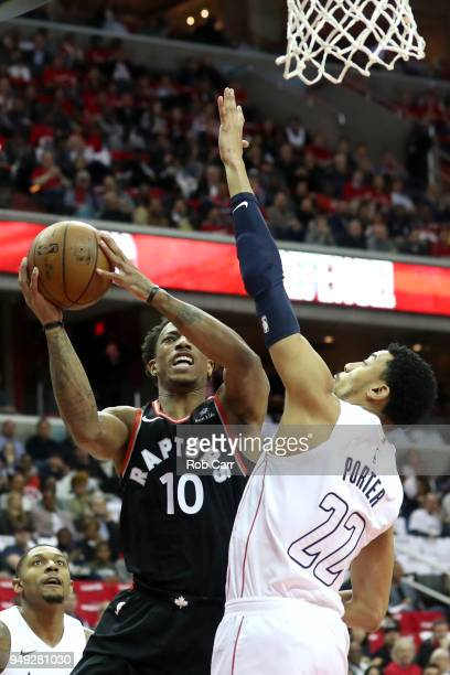 DeMar DeRozan of the Toronto Raptors puts up a shot in front of Otto Porter Jr #22 of the Washington Wizards in the first half during Game Three of...