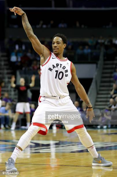 DeMar DeRozan of the Toronto Raptors reacts after a shot against the Charlotte Hornets during their game at Spectrum Center on February 11 2018 in...