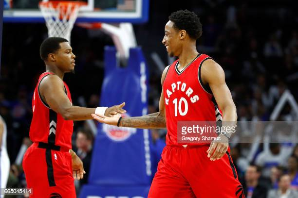 DeMar DeRozan of the Toronto Raptors reacts with Kyle Lowry after hitting a late fourth quarter jump shot while playing the Detroit Pistons at the...