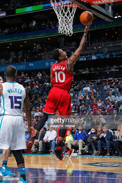 DeMar DeRozan of the Toronto Raptors shoots a layup against the Charlotte Hornets on December 17 2015 at Time Warner Cable Arena in Charlotte North...