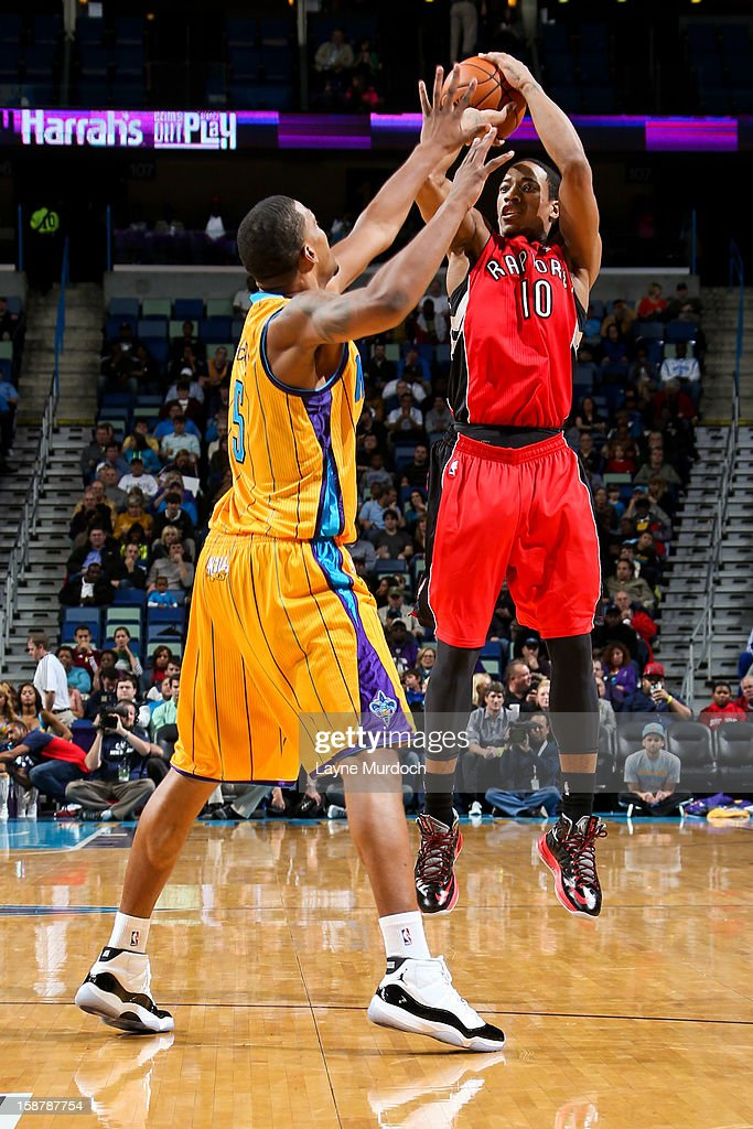 DeMar DeRozan #10 of the Toronto Raptors shoots a three-pointer against Dominic McGuire #5 of the New Orleans Hornets on December 28, 2012 at the New Orleans Arena in New Orleans, Louisiana.