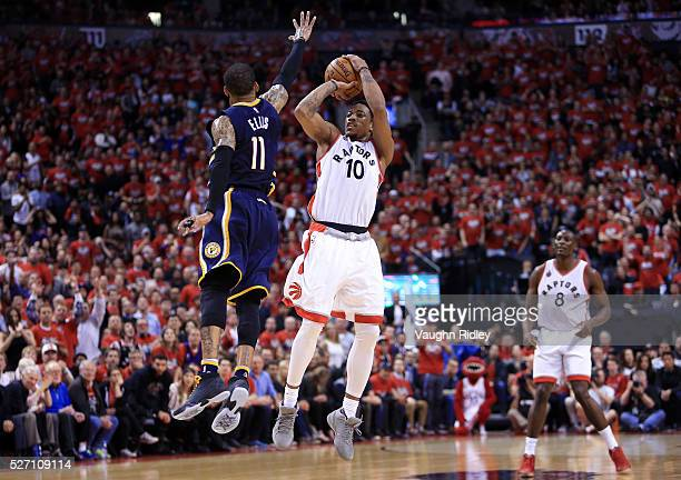 DeMar DeRozan of the Toronto Raptors shoots a threepointer as Monta Ellis of the Indiana Pacers defends in the second half of Game Seven of the...
