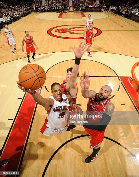 DeMar DeRozan of the Toronto Raptors shoots against Carlos Boozer of the Chicago Bulls on February 23 2011 at the Air Canada Centre in Toronto...