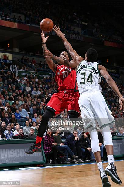 DeMar DeRozan of the Toronto Raptors shoots against Giannis Antetokounmpo of the Milwaukee Bucks during the game on December 26 2015 at BMO Harris...