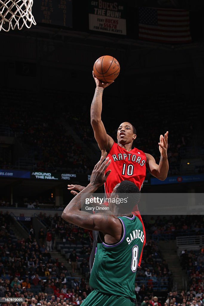 DeMar DeRozan #10 of the Toronto Raptors shoots against Larry Sanders #8 of the Milwaukee Bucks on March 2, 2013 at the BMO Harris Bradley Center in Milwaukee, Wisconsin.