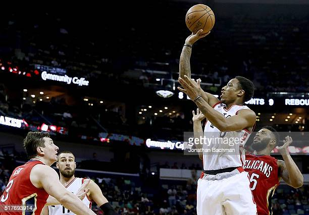 DeMar DeRozan of the Toronto Raptors shoots over Omer Asik of the New Orleans Pelicans during the second half of a game at the Smoothie King Center...