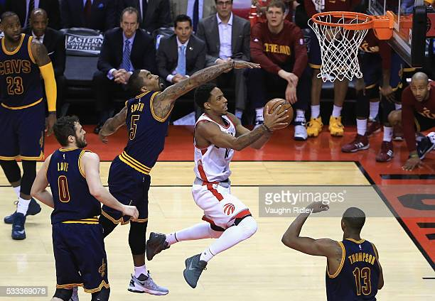 DeMar DeRozan of the Toronto Raptors shoots the ball against JR Smith of the Cleveland Cavaliers during the second half in game three of the Eastern...