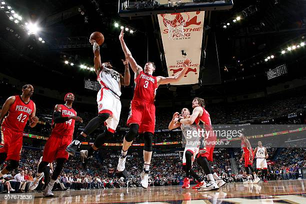 DeMar DeRozan of the Toronto Raptors shoots the ball against Omer Asik of the New Orleans Pelicans on March 26 2016 at Smoothie King Center in New...