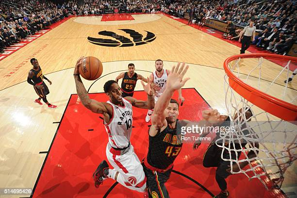 DeMar DeRozan of the Toronto Raptors shoots the ball against the Atlanta Hawks on March 10 2016 at the Air Canada Centre in Toronto Ontario Canada...