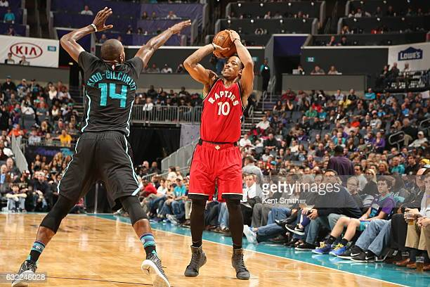 DeMar DeRozan of the Toronto Raptors shoots the ball against the Charlotte Hornets on January 20 2017 at Spectrum Center in Charlotte North Carolina...