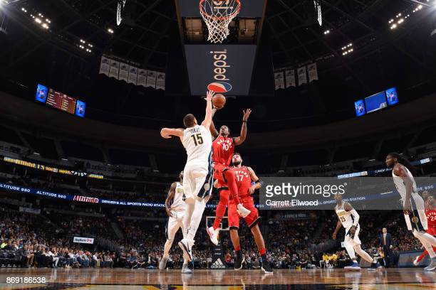 DeMar DeRozan of the Toronto Raptors shoots the ball against the Denver Nuggets on November 1 2017 at the Pepsi Center in Denver Colorado NOTE TO...