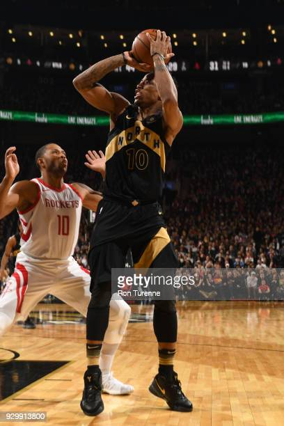 DeMar DeRozan of the Toronto Raptors shoots the ball against the Houston Rockets on March 9 2018 at the Air Canada Centre in Toronto Ontario Canada...