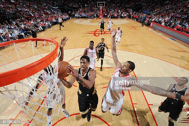 DeMar DeRozan of the Toronto Raptors shoots the ball against Trevor Ariza of the Houston Rockets on March 25 2016 at the Toyota Center in Houston...