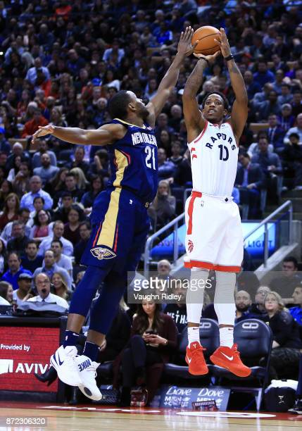 DeMar DeRozan of the Toronto Raptors shoots the ball as Darius Miller of the New Orleans Pelicans defends during the second half of an NBA game at...